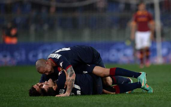 Cagliari celebrates against Roma