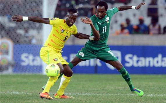 Komlan Amewou of Togo battles with Jonathan Pitroipa of Burkina Faso during the Orange Africa Cup of Nations