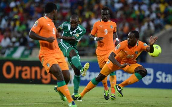 Sunday Mba of Nigeria scoring a goal against Ivory Coast