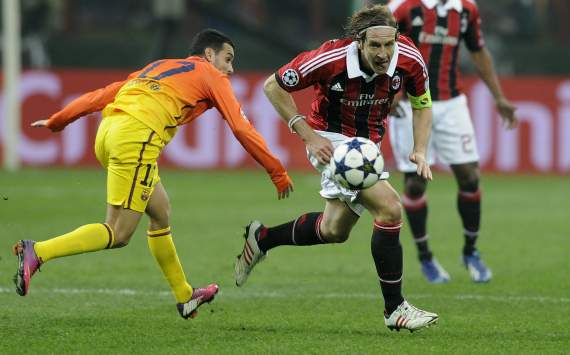 Milan's Ambrosini wary of Barcelona progression