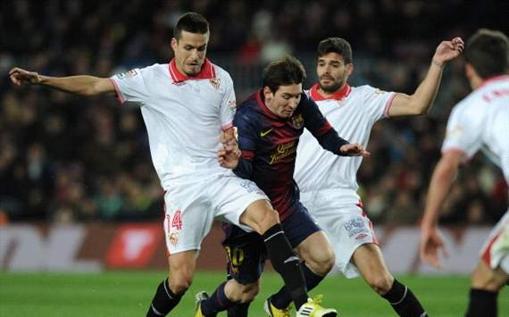 Brittle Barcelona scrape past Sevilla