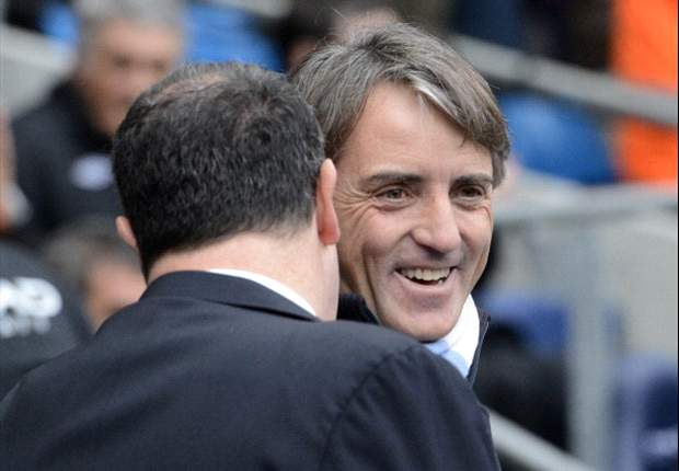The title race is not over, insists Manchester City boss Mancini