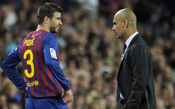 Pique and Pep Guardiola