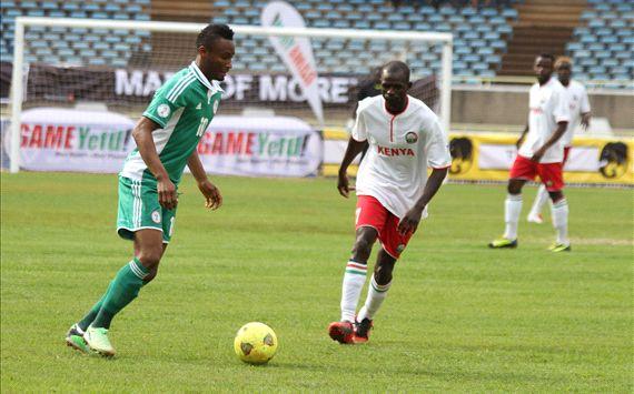Kenya midfielder Peter Opiyo andf John Obi Mikel of Nigeria.
