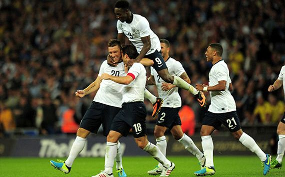 Rickie Lambert and England players celebrate against Scotland