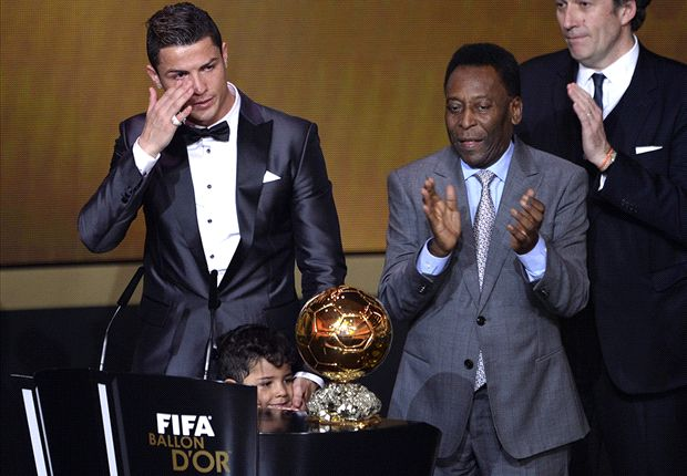 Ronaldo is visibly moved as he accepts the award from Pele, accompanied by his son