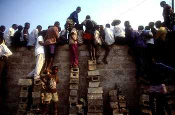 Zambian fans climbing walls to watch their team