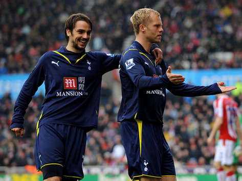 Eidur Gudjohnsen of Tottenham celebrates scoring the first goal with team mate Niko Kranjcar during the Barclays Premier League match between Stoke City and Tottenham(Getty Images) gig